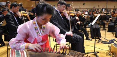 The Unhasu Orchestra tunes up in Paris. [Photo: Reuters]