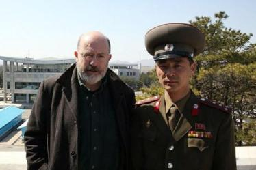John Sweeney with DPRK military official at Panmunjom (frame capture from BBC documentary)