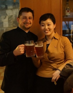 Josh Thomas and Ms Yu, one of the North Korean guides, enjoy draft beers at the bar of the Yanggakdo Hotel Microbrewery. (Photo by Joseph A Ferris III)