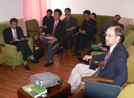 Randall Ireson (far right) at an agricultural seminar in Pyongyang with officials of the Ministry of Agriculture and the Academy of Agricultural Sciences (Photo by Erich Weingartner)