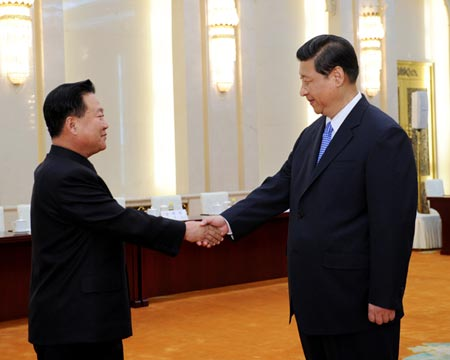 Xi, right, and Pyongyang's special envoy Choe Ryong-hae meet in Beijing. (Photo by Xinhua)