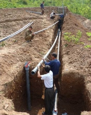 Installing pipes for safe drinking water (Photo by Dan Folta)